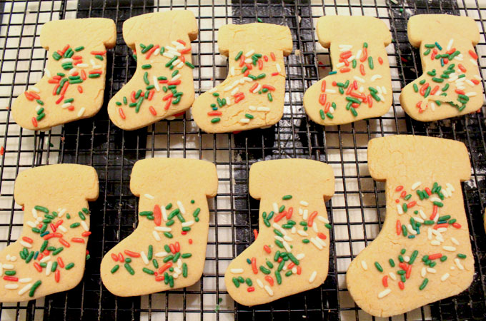 Adding Sprinkles to the Peanut Butter Christmas Cookie Stockings