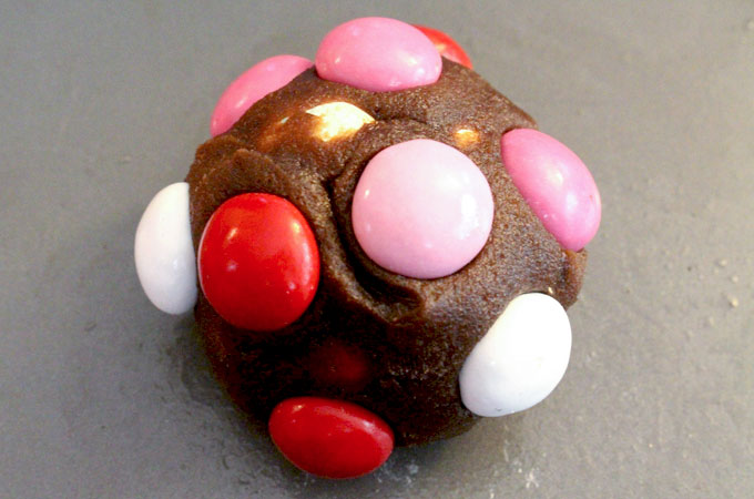 Add more Peanut Butter M&M's to the cookie dough ball
