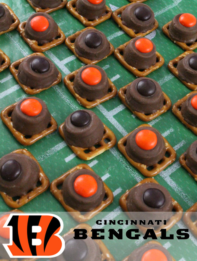 Our easy to make Cincinnati Bengals Pretzel Bites are yummy bites of sweet and salty Football Game Day goodness. They are perfect as a little extra treat at a NFL playoff party, a Super Bowl party or as a special dessert for the Cincinnati Bengals fan in your life. Follow us for more fun Super Bowl Food Ideas.