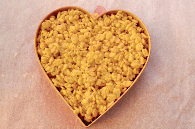 Mold Rice Krispie Treat mixture into the Heart Cookie Cutter
