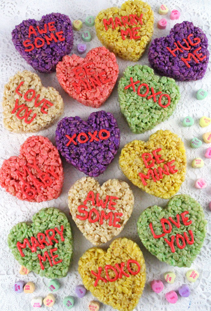 Conversation Hearts Rice Krispie Treats - Using only a heart cookie cutter we transformed Rice Krispie Treats into these adorable Valentine's Day Treats! They are a colorful and festive Valentine's Day dessert that everyone will love mimicing the classic Valentine's Day candy.  Follow us for more fun Valentine's Day Food Ideas.