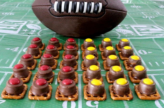 Our easy to make Kansas City Chiefs Pretzel Bites are yummy bites of sweet and salty Football Game Day goodness. They are perfect as a little extra treat at a NFL playoff party, a Super Bowl party or as a special dessert for the Kansas City Chiefs fan in your life. Follow us for more fun Super Bowl Food Ideas.