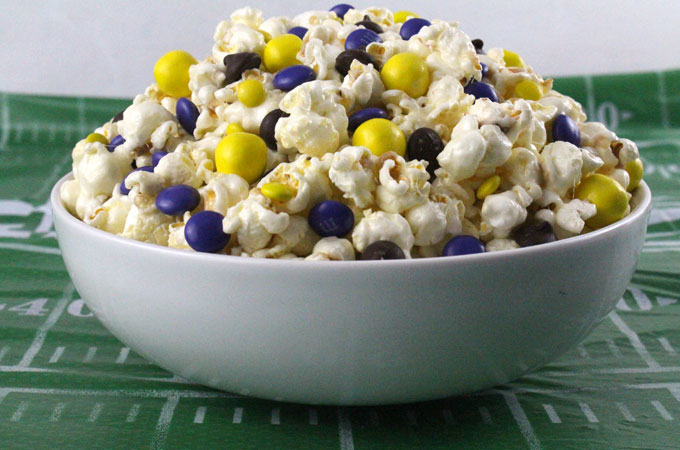 Minnesota Vikings Popcorn for those Minnesota Vikings fans in your life. Sweet, salty, crunchy and delicious and it is extremely easy to make. This delicious popcorn will be perfect at your next game day football party. a NFL playoff party or a Super Bowl party. Follow us for more fun Super Bowl Food Ideas.