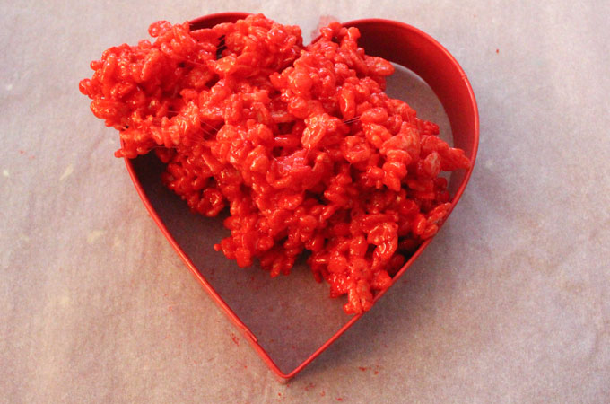 Spoon Rice Krispie Treat mixture into large Heart Cookie Cutter