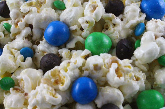 Seattle Seahawks Popcorn for those Seattle Seahawks fans in your life. Sweet, salty, crunchy and delicious and it is extremely easy to make. This delicious popcorn will be perfect at your next game day football party. a NFL playoff party or a Super Bowl party. Follow us for more fun Super Bowl Food Ideas.