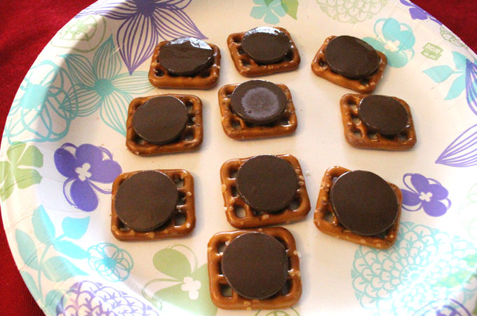 Melting Chocolate Wafers on the Pretzel Snaps