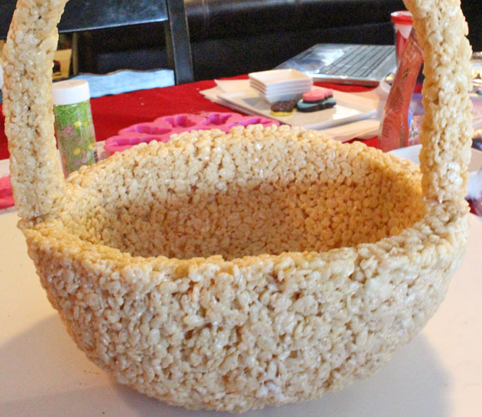 Adding the handle to the Rice Krispie Treat Easter Basket