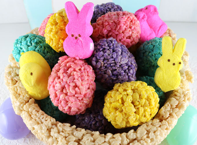 This gorgeous Rice Krispie Treat Easter Basket Centerpiece will be everyone's favorite Easter decoration. A fun Easter Craft that you can make for your own Easter brunch or Easter dinner table. Filled with tasty Rice Krispie Treat Easter Eggs, this fun centerpiece will wow your guests! Follow us for more amazing Easter ideas.