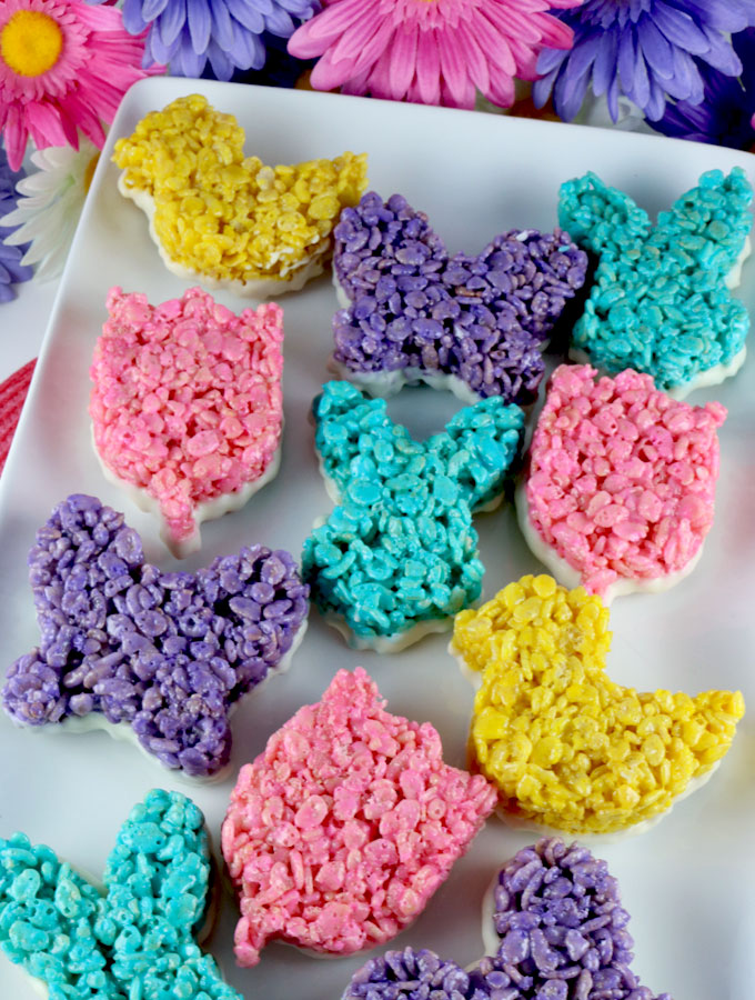 Springtime Rice Krispie Treats - an Easter dessert that is fun, easy and delicious. Your family will love this unique Easter treat that is dipped in yummy White Chocolate. Follow us for more great Easter Food Ideas.