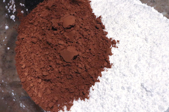 Add Cocoa Powder and Powdered Sugar to a mixing bowl