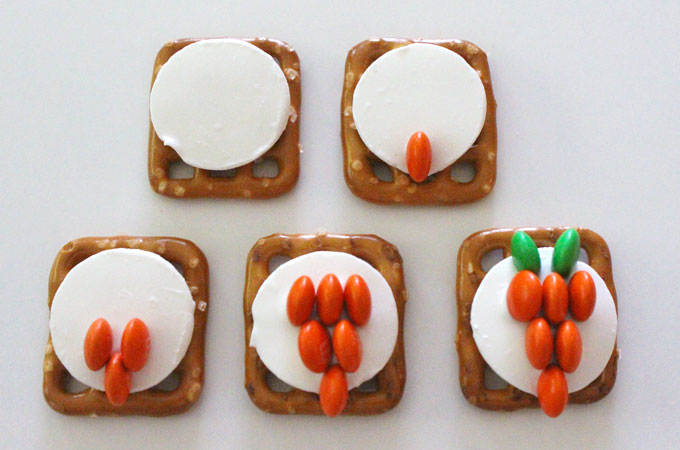 Assembling the Easter Bunny Carrot Pretzel Bites