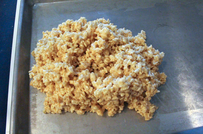 Pour the Rice Krispie Treat mixture into a cookie shieet