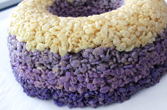 Continue adding all of the color Rice Krispie Treat mixture layers