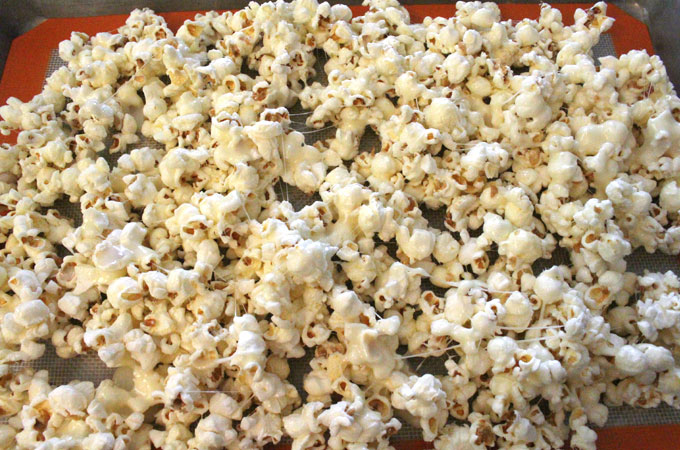 Pour Celebration Popcorn into a cookie sheet
