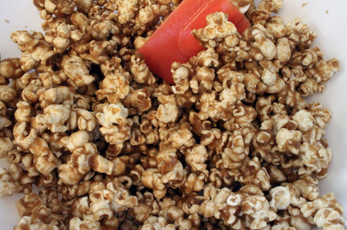 Pour Caramel mixture onto popcorn
