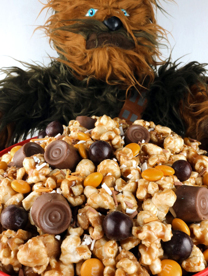 Wookie lovers rejoice - our Chewie Chewy Star Wars Caramel Corn is a homemade popcorn treat that Chewbacca would definitely love. It would be a great for a Star Wars Birthday Party dessert, Star Wars movie Marathon snack or a Family Movie Night treat. Yummy, buttery Caramel Popcorn that is ready to eat in less than 15 minutes. Pin this delicious Star Wars popcorn treat for later and follow us for more great Star Wars Party Ideas.