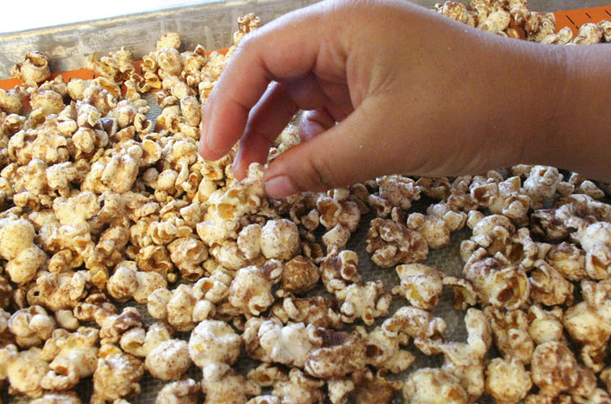 Pour Cinnamon Toast Popcorn onto a Cookie Sheet