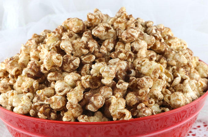 Cinnamon Toast Popcorn - a twist on a classic breakfast treat. Crunchy popcorn, yummy melted butter and delicious cinnamon sugar combine into a new classic popcorn snack. This is a family movie night dessert that your family will beg you to make again and again. Pin this popcorn treat for later and follow us for more Popcorn Recipes.