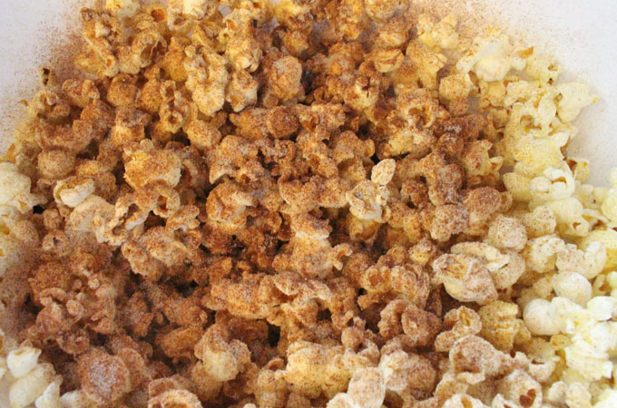 Add Cinnamon Sugar to buttered popcorn