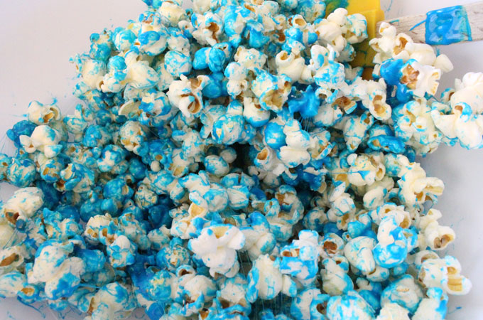 Mix marshmallow mixture with popcorn