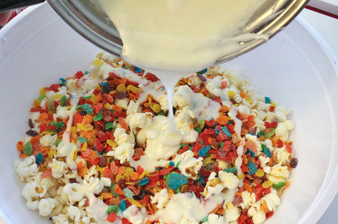 Pour Marshmallow Mixture over Popcorn and Fruity Pebbles