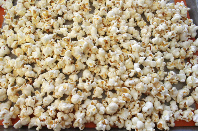 Pour popcorn into a Cookie Sheet