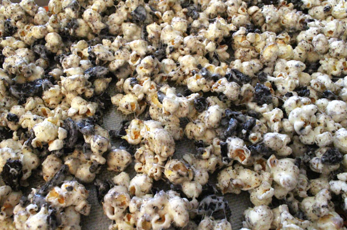 Pour Oreo Cookie Popcorn into a cookie sheet