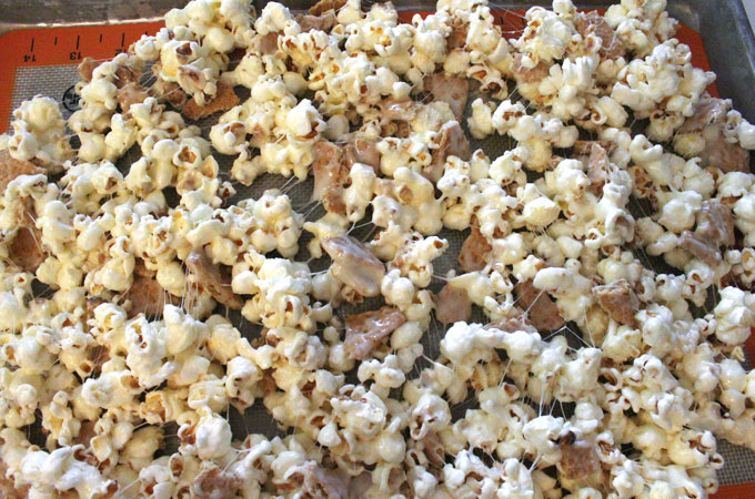 Pour S'mores Popcorn onto a cookie sheet