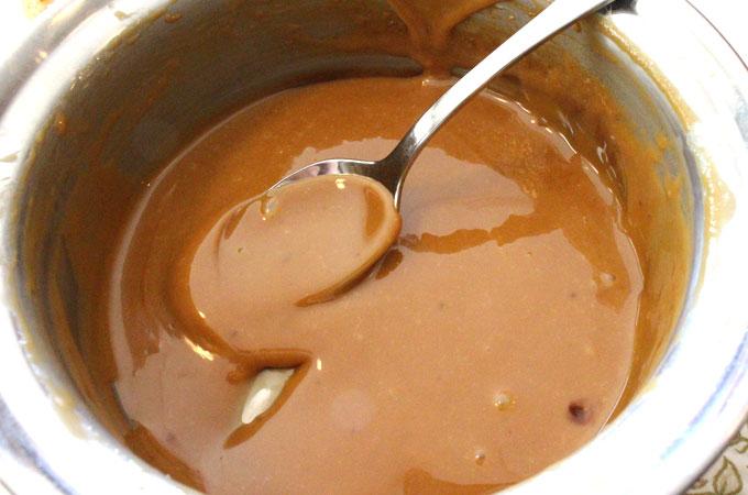 Melt Caramel in a saucepan