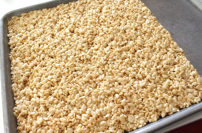 Press Rice Krispie Treat Mixture into a Cookie Sheet