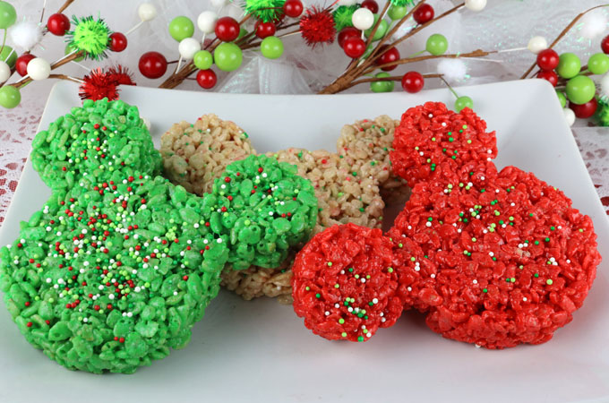 Christmas Mickey Mouse Rice Krispie Treats- These colorful and festive Christmas Treats will be a fun addition to your Christmas baking list. We used a Mickey Mouse Cookie Cutter to make these adorable and yummy Rice Krispie Treats for a Holiday Party. This is a colorful and festive Disney Christmas Dessert that everyone will love. Follow us for more fun Christmas Food Ideas.