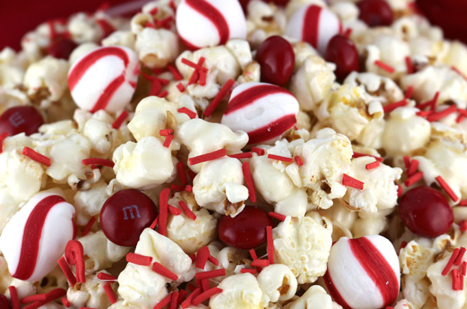 Christmas Mint Popcorn - Peppermint lovers rejoice this delicious Sweet and Salty homemade popcorn is just the Christmas Treat that you have been looking for. It would be a great Christmas Dessert for a Holiday Party or a Christmas-time Family Movie Night. Pin this festive Red and White Christmas popcorn for later and follow us for more great Christmas Food Ideas.