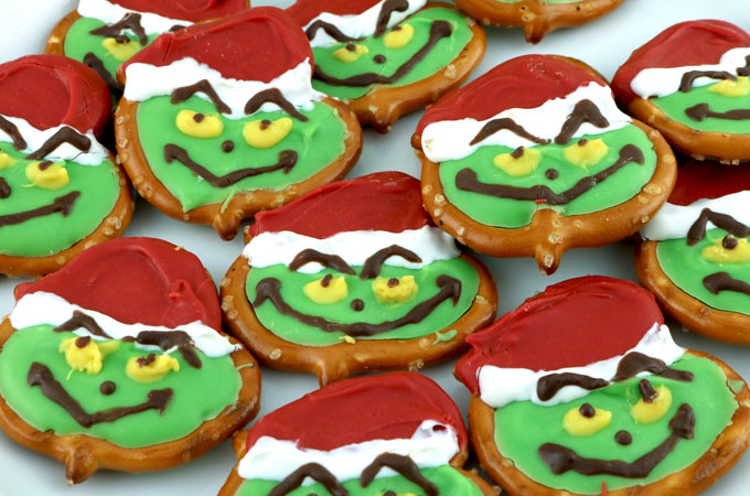 Grinch Pretzels are a cute and fun to make Christmas Treat that is perfect for a How the Grinch Stole Christmas family movie night. The kids will love to help make this Grinchy Christmas Dessert. Pin this adorable Christmas Candy for later and follow us for more fun Christmas Food Ideas.