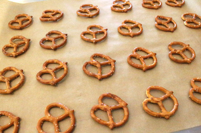Lay out pretzels on a cookie sheet