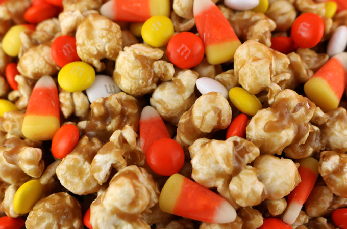 ... caramel corn and immediately sprinkle the candy on the areas with the
