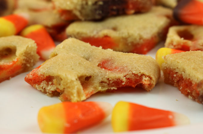 Candy Corn Cookie Bark - a thin and crispy cookie chock full with yummy Candy Corn. Crunchy and chewy at the same time it is a yummy Fall or Halloween Treat. Easy to make and super delicious, this unique cookie would be a great dessert for this year's Halloween Party. Pin this delicious Halloween Cookie for later and follow us for more great Halloween Food Ideas.