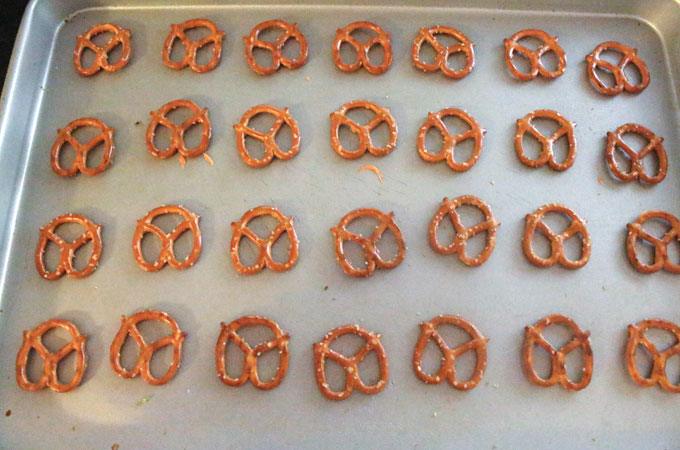 Layout pretzels on a cookie sheet
