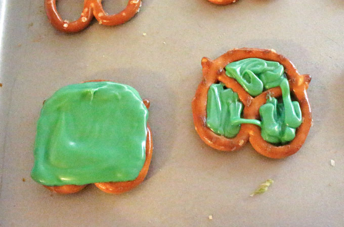 Cover pretzel with green candy melt mxiture