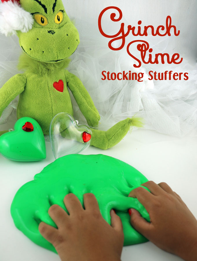 Our Grinch Slime - fun and colorful homemade GAK that would be great as a Christmas Stocking Stuffer or a Holiday Party Favor. We have step by step directions on how to make this easy to make DIY Christmas Craft. The kids will love playing with this ooey, gooey Holiday sensory activity. Follow us for more fun Christmas DIY Gifts.
