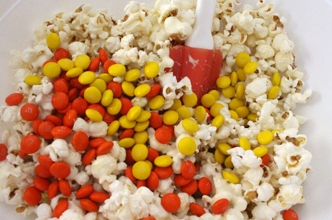 Pour M&M's into the Popcorn Mixture