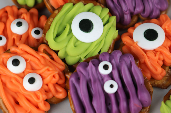 Monster Pretzel Bites - you'll only need pretzels, candy melts and googly monster candy eyeballs to make these scary, sweet and salty Halloween treats. This fun Halloween dessert will be a big hit at your Halloween Party this year and would be great for a Fall Bake Sale. Pin this easy Halloween Candy for later and follow us for more great Halloween Food Ideas.