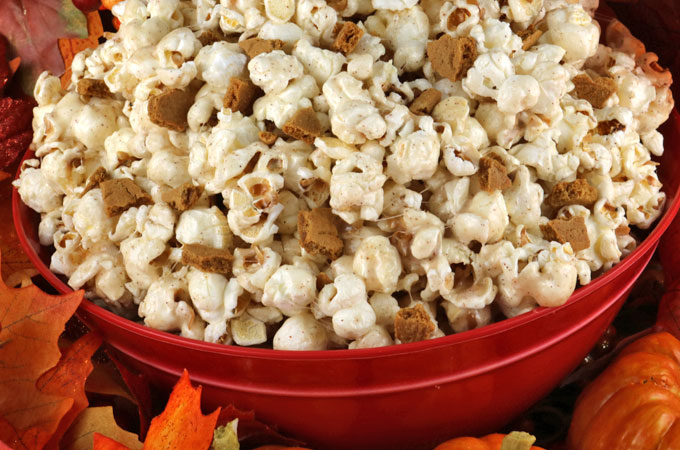 Pumpkin Spice Popcorn - sweet and salty popcorn covered in marshmallow with just a hint of delicious pumpkin spice. Mix in a handful of yummy Gingersnaps and you have a Fall treat that is sure to please. This easy to make Fall dessert would be a great Thanksgiving Party Food or a Fall movie night treat! Pin this amazing Thanksgiving Treat for later and follow us for more fun Thanksgiving and Fall Food ideas.