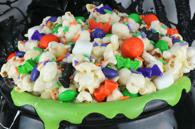 Trick or Treat Halloween Popcorn is a yummy and colorful Halloween Dessert that is super easy to make! This Halloween snack is sweet, salty and delicious. Pin this yummy Halloween treat for later and follow us for more great Halloween Food Ideas.