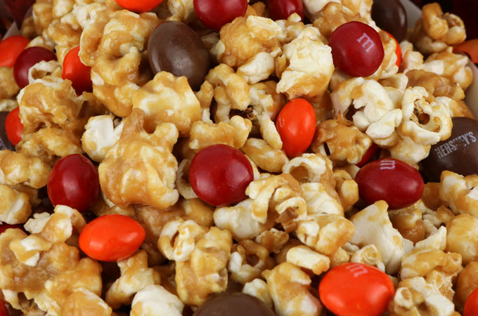 Peanut Butter Popcorn - sweet and salty popcorn covered in peanut butter, marshmallows and yummy Peanut Butter M&M's. A delicious Peanut Butter dessert that is super easy to make! It would be a great Halloween Treat or a Fall movie night dessert! Pin this delicious popcorn treat for later and follow us for more great Thanksgiving Food Ideas.