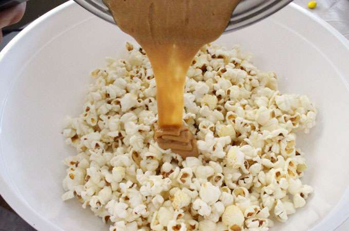 Pour peanut butter mixture into the popcorn