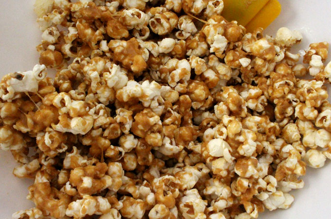Cover the popcorn with the peanut butter mixture