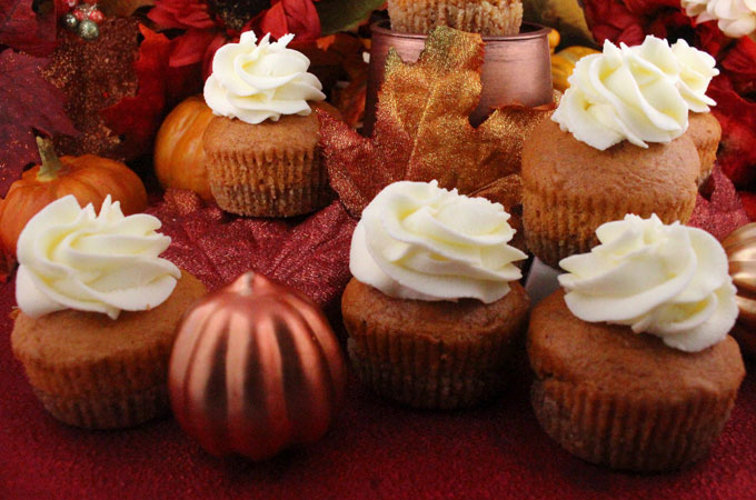 Pumpkin Pie Cupcakes - buttery Nilla Wafter Crust plus pumpkin spice cake plus Whipped Cream Frosting in one unique and delicious Holiday Cupcake. These special Halloween cupcakes are easy to make and taste as amazing as they look! Your family, friends and party guests will be impressed when you serve this super yummy two-in-one Thanksgiving Dessert instead of pie. Pin this delicious Christmas Treat for later and follow us for more fun Thanksgiving Food Ideas.