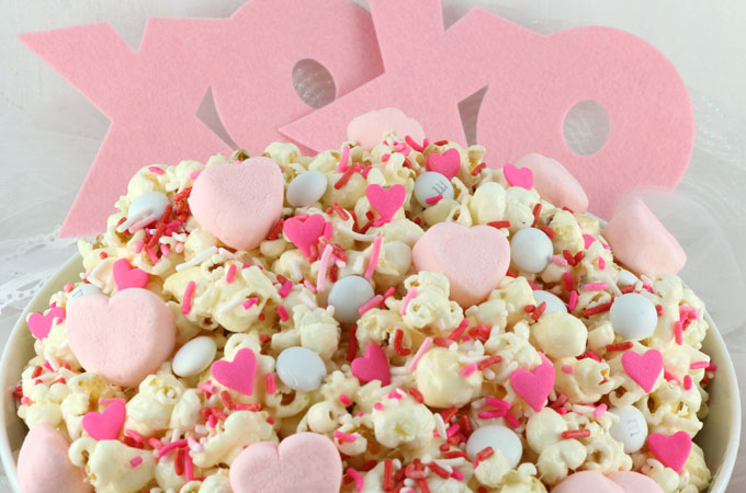 "Marshmallow Heart Popcorn - a fun Valentines Day treat. Sweet, salty, crunchy and delicious and it is so easy to make. Say ""I Love You"" with this easy to make Valentine's Day dessert. Pin this great Popcorn recipe for later and follow us for more fun Valentines Day Food ideas."