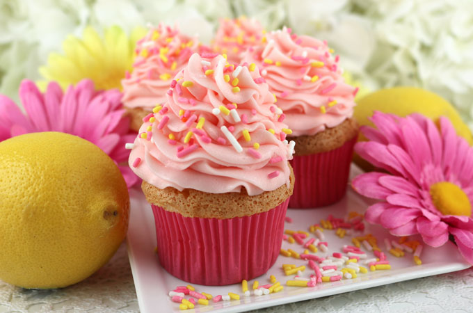 Angel Food Cupcakes with Pink Lemonade Frosting - Two Sisters