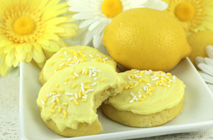 Lemon Cookies with Lemon Frosting - buttery, cakey cookies with just a hint of lemon covered with our creamy, lemony buttercream frosting. Bright and fresh and super delicious. This cookie recipe would be a great dessert for Easter, Mother's Day, a Spring Brunch or just as a special treat for that lemon-lover in your family. Pin this tasty lemon dessert for later and follow us for more great Easter Food Ideas.